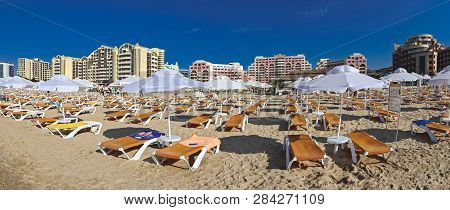 Sunny Beach, Bulgaria - July 7: Empty Loungers Under Sunshades And Sandy Beach At Sunny Beach On Jul