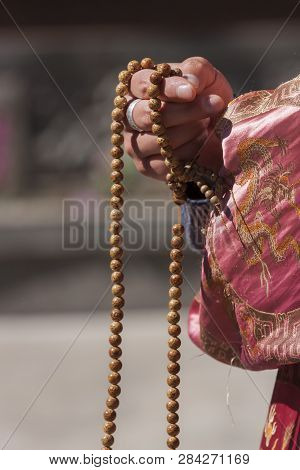 Shaolin Chinese Monk Holding Buddhist Beads In Hand.