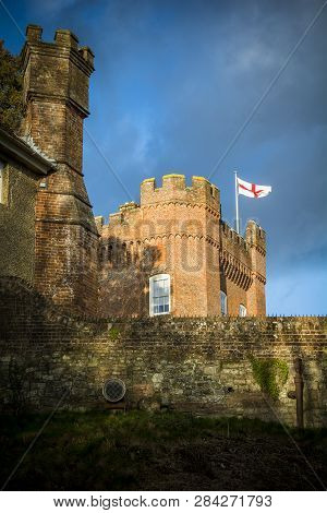 England Flag Fluttering Above English Castle In Surrey