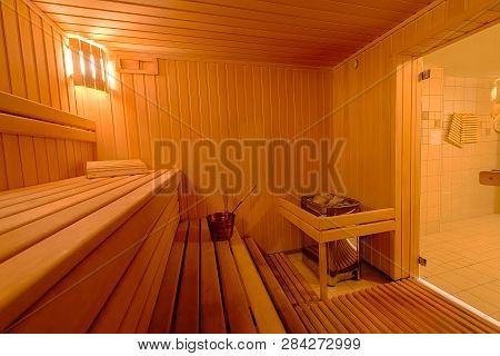 Sauna Room Interior As Background, Spa Room. Relax In A Hot Sauna, Finland-style Classic Wooden Saun