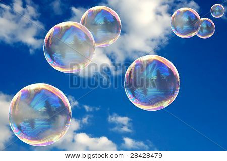 Soap bubbles on blue sky