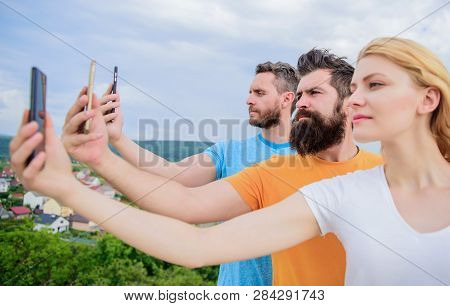 Selfie Brought By Self Confidence. Pretty Woman And Men Holding Smartphones In Hands. Best Friends T