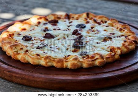 Flatbread with cheese and olives