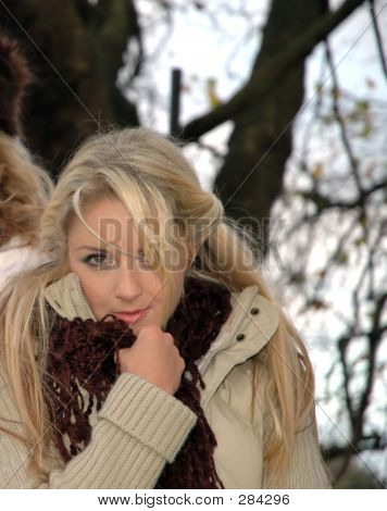 young female model keeping warm in the winter season