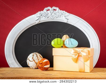 An image of an Easter decoration gift box eggs and vintage frame