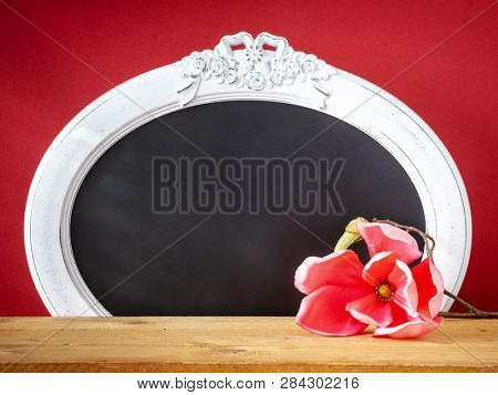 An image of a spring decoration magnolia flower and vintage frame
