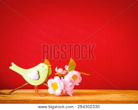An image of a bird with a branch of blossoms easter holiday decoration background
