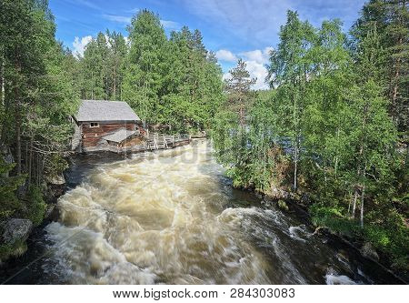 Old Watermill Along The Fast-moving Myllykoski Rapids At The Oulanka National Park In Kuusamo, Finla