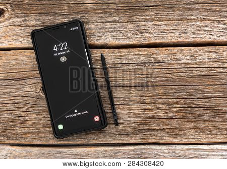 Ukraine, Uzhgorod - February, 14, 2019: Studio Shot Of Samsung Galaxy Note 9 Smartphone On A Wooden