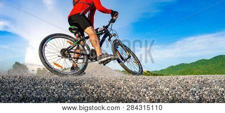 Cyclist Riding Mountain Bike On The Rocky Trail At Sunset, Extreme Mountain Bike Sport Athlete Man R