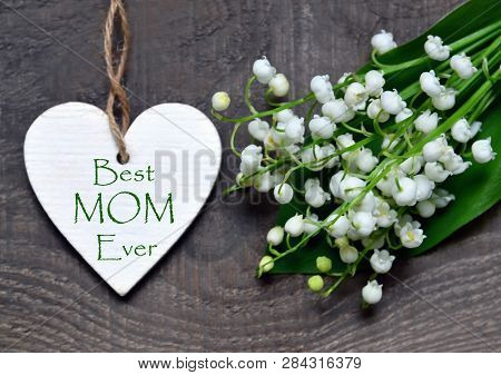 Best Mom Ever.bouquet Of Lilies Of The Valley And Decorative Heart With Greeting Text On Wooden Back