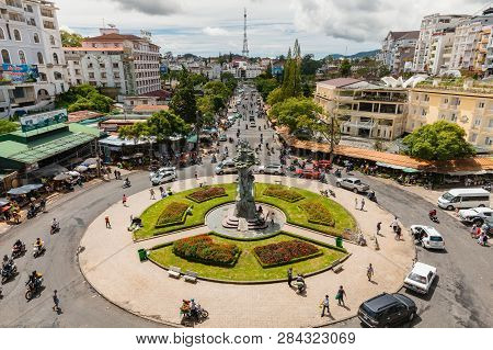 Dalat, Vietnam - September 23, 2018: People Walk And Ride A Motorbike At The Central Market Square O