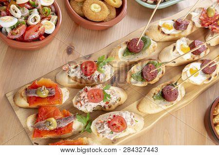 Top View Of A Variety Of Snacks - Spanish Tapas Or Italian Antipasti