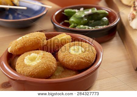 Spanish Tapas Appetizers - Breaded Fried Cheese In A Bowl
