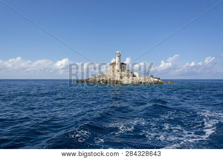 Mulo Lighthouse In Croatia On Small Rocky Island