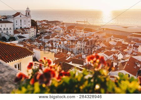 Sunrise Over Lisbon Old Town Alfama - Portugal. Lisbon Golden Hour Skyline. Sun Rising Over Tagus Ri
