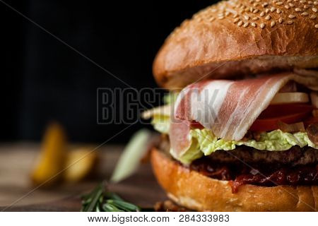 Classic American Beef Burger. Unhealthy Food Concept. Fasrfood On Dark Background.