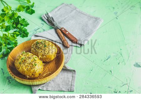 Delicious Portion Baked Potatoes In Wooden Plat
