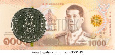 1 New Thai Baht Coin Against 1000 New Thai Baht Banknote