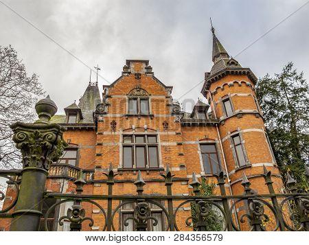 Villa Steisel or Villa des Lilas in Malmedy, Belgium built in 1897, exterior partial view under a moody overcast November sky poster