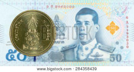 2 New Thai Baht Coin Against 50 New Thai Baht Banknote