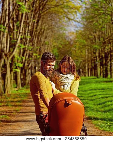 Family Relations. Woman And Man Walk With Baby Pram In Park, Happy Relations. The Right Relationship