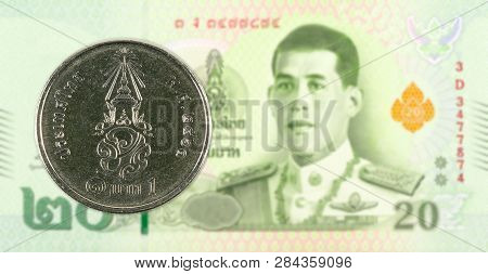 1 New Thai Baht Coin Against 20 New Thai Baht Banknote