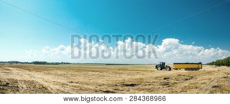 Tractor Working On The Farm, A Modern Agricultural Transport, A Farmer Working In The Field, Fertile