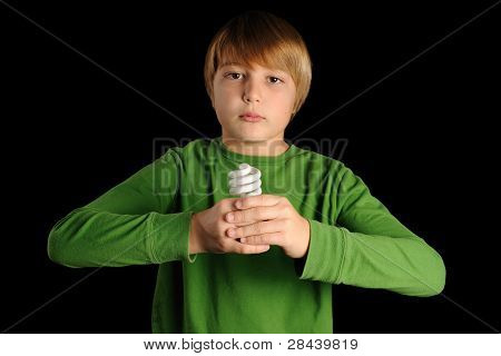 Young Boy Holding CFL Bulb