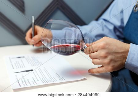 Male Sommelier Is Checking And Testing Red Wine
