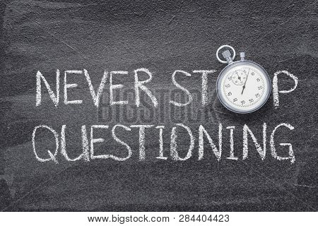 Never Stop Questioning Written On Chalkboard With Vintage Precise Stopwatch Used Instead Of O