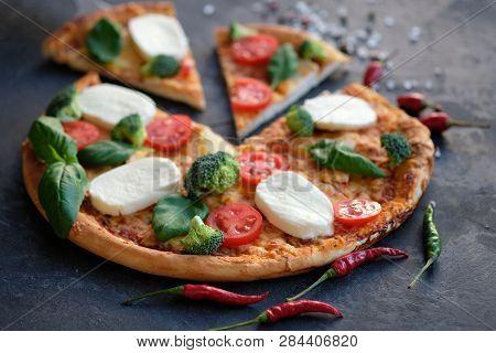 Sliced Pizza With Mozzarella Cheese, Tomatoes, Broccoli, Spices And Fresh Basil. Italian Pizza. Pizz