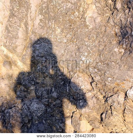 The Shadow Of The Photographer On The Stone Surface Background Of The Cliff In The Summer Or Photogr