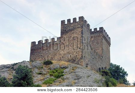 Beautiful Old Ancient Mountain Castle - Genoese Fortress With Stone Walls With Battlements On Top Of