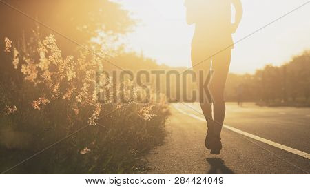 Young Fitness Sport Woman Running On The Road In The Morning, Sun Light Flare