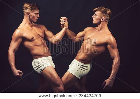 Friendship Of Men Do Gymnastic. Friendship Of Twins Men With Muscular Body In Bodybuilder Pose