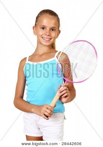 Pretty teenage girl with racket in studio on white background