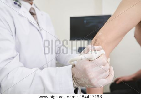 Cropped Close Up Of Medical Process Of Hand Diagnosis. Doctor Holding Device, Using Ultrasound Probe