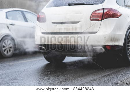 Car Pipe Exhaust Release Smoke. Air Pollution Concept