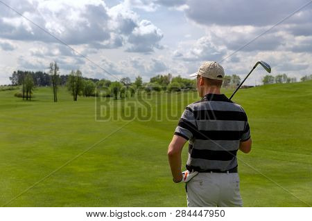 Man Golfer Standing At Fairway On Golf Course