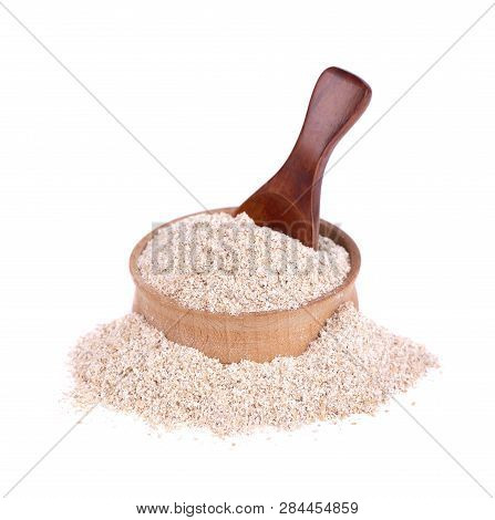 Wheat Bran In A Small Wooden Bowl, Isolated On White. Wheat Germ, The Highly Nutritious Heart Of The