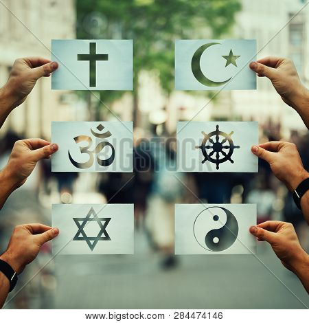 Religion Conflicts As Global Issue Concept. Human Hands Holding Different Paper With Faith Symbols O