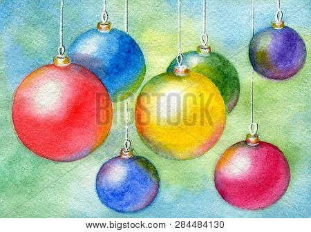 Multicolored Christmas Balls Hanging On Abstract Background