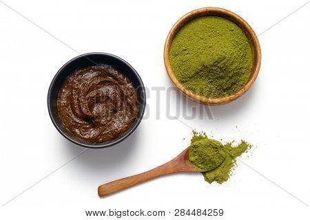 Herbal Henna powder and henna paste on white background.