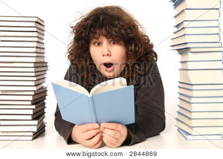 Boy Surprised And Many Books