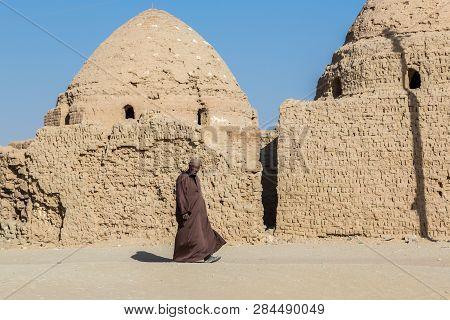 Dakhla Oasis, Egypt - Nov 23, 2018: Local Arabian Egyptian Man Walking Dressed In National Male Dres