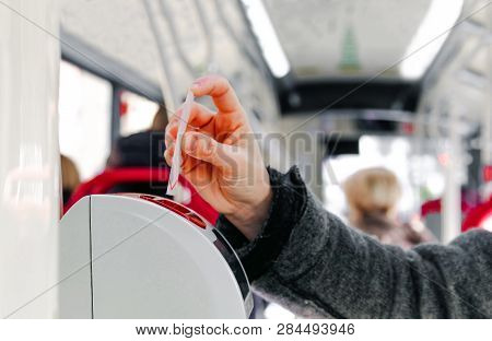 bus ticket insert in validator hand background poster