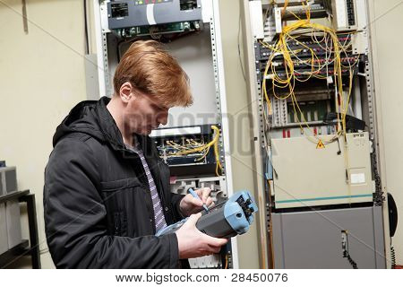 Telecom Engineer Adjusting Reflectometer