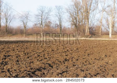 Freshly Plowed Land. A Brownish Relief Texture. Loose Soil For Planting. Agriculture. Agricultural B