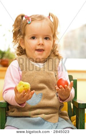 Little Girl With Easter Egg And Chicken